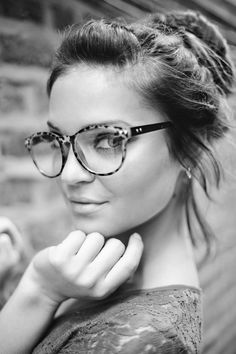 Tie your hair up in loose bun and throw on a pair of sharp glasses with high contrast print for an effortless casual