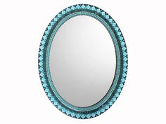 Large mosaic wall mirror in an oval shape featuring a color scheme of teal, turquoise, and aqua glass, silver accents, and black grout. This decorative mirror …
