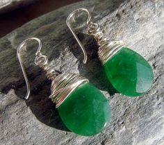 Emerald green earring wrapped in silver wire