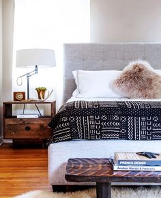 7 bad dcor shopping habits to stop right now eclectic bedroom with black and white mudcloth bedcover love the light grey headboard and faux fur pillow