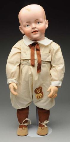 """Splendid K & H Character Toddler Doll. German bisque socket head incised """"K & H 548"""" with solid dome head and painted hair, multistroked eyebrows, painted blue intaglio eyes with red eyelid line and black eyelash line, large ears, open/closed mouth, dimples."""