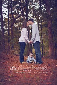So real and true to life----baby is enthralled with leaves so just get a shot of parents kissing with baby crawling around at their feet to show this stage of life with a little one.