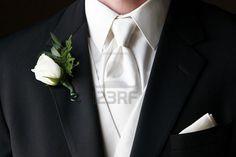 White tie and handkerchief in pocket