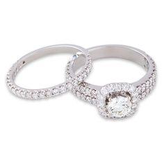 Pretty Platinum Rebecca Round Brilliant Halo Engagement Ring with matching diamond set wedding band.