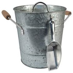 """Serve a scotch on the rocks or chill a bottle of bubbly with this handsome ice bucket, showcasing a galvanized finish and complementary ice scoop.     Product: Ice bucket, lid and scoopConstruction Material: Metal and woodFeatures: Two handles Color: SilverDimensions:  10.5"""" H x 9.5"""" W x 8.5"""" D (ice bucket)"""