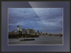 """""""East River Dawn"""" by Paul Coco, Brooklyn, NY // Early morning (6:33 AM to be precise) in the Big Apple. The tug and barge in the foreground are passing Governors Island. On the left is Freedom Tower, still under construction when I took this image (September 2012). On the right is the East River leading to the Brooklyn Br... // Imagekind.com -- Buy stunning fine art prints, framed prints and canvas prints directly from independent working artists and photographers."""