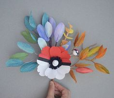 Pokebouquet made from crepe paper Anemone pokeball with foliage that represents the colors of #Bulbasaur, #Squirtle, #Pikachu and #Charmander  #pokemon #pokemongo #pokebouquet #pokeflower #paperflowers #craftsposure #paperart #papercraft #ohwowyes #bostonflorist #flowers #dsfloral #makersmovement  #makersgonnamake #makersbiz #larsflowers #foundand...