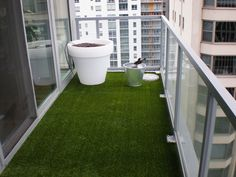 Astroturf on a balcony. I will be doing this to my new place. :)
