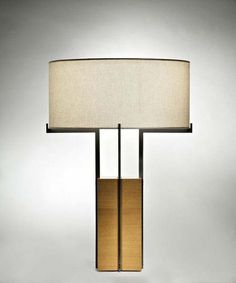 Anke Table Lamp Design By Jaime Tresserra Table lamp in light/dark walnut wood. Metal fittings: shiny silver nickel/matt black nickel. Ribbed lampshade in cream color. Incandescent bulb 220v with intensity regulation system.