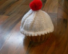 hand knitted baby cupcake hat / baby cupcake cap / hat with red cherry pompom newborn