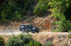 Land Rover Defender 110 Tdi Sw working in Mountain way.