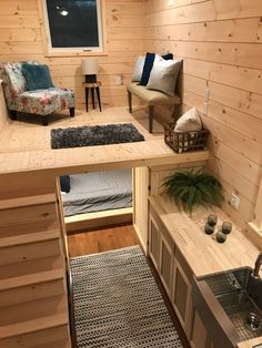 """The rustic tiny home has natural wood finishes and 3/4"""" Kentucky Oak hardwood floors throughout."""
