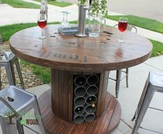 OH The memories :)Cable Reel Up Cycled, Pub Height Table. With Draft tower & wine storage