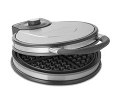 Calphalon Classic Round Waffle Maker.  The BEST waffle maker I've ever owned.  Perfect size waffles for kids.  And NOT BELGIAN.  I prefer classic waffles. The non-stick on this waffle maker is fab.