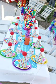 Circus Birthday Party...love the craft pom topiaries and clown noses on the party hats!