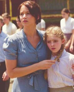 Katniss and Prim (Primrose Everdeen, Katniss's sister played by Willow Shields)