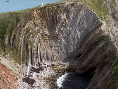 When the continents of Africa and Europe collided 24-1.5 million years ago the effects were far reaching causing changes in the rock formations many hundreds of miles away.  The rocks at Lulworth were lifted, twisted and folded over 90 into their present position. The collision of the earth's tecton...