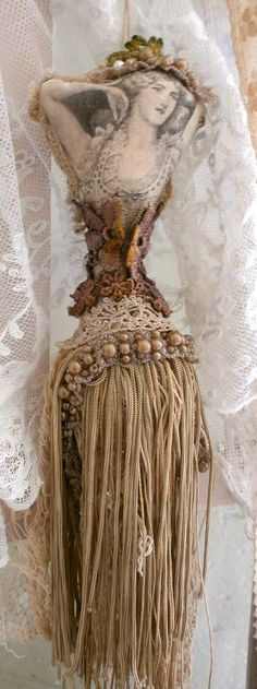 art doll tassel. Sculpted and stuffed body 16 inches tall. Embellished with beads, hand dyed lace and fringe. Frays