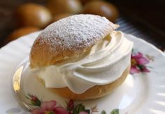 Simple brioche dough transforms into a lovely Scottish bun which is glazed, filled with fresh cream and then dusted with powdered sugar! One of the best things you'll ever taste! #scottish #creambuns #scottishfood
