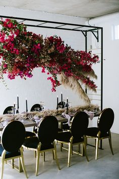 Suspended bougainvillea floral and pampas grass centerpiece for modern chic wedding reception