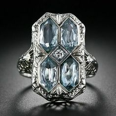Antiques Rings A aquamarine Art Deco filigree ring in 14 karat white gold. Four pale hexagonal cut aquamarines are set across the top and centred with a Anel Art Deco, Art Deco Schmuck, Bijoux Art Nouveau, Art Deco Jewelry, Fine Jewelry, Jewelry Design, Jewellery Uk, Antique Rings, Antique Jewelry