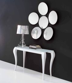 ghost I Console Table s made of lacquered solid wood legs and has a lacquered   glass top