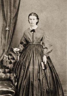 Plaid top, plain bottom.  1860s two piece dress.  I could wear this.
