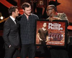"""Phillip Phillips receives a plaque signifying his quadruple platinum single """"Home"""" on AMERICAN IDOL Thursday, March 14."""