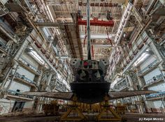 After five years searching the internet for the abandoned and forgotten, it takes a lot to shock me these days. But this. This, is something you don't see everyday. Inside a remote rusting warehouse in the Kazakhstan desert that once housed the Soviet space shuttle program, Russian urbex photographer managed to gain access inside the hulking…