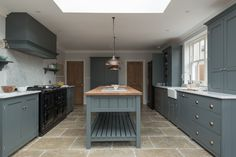 beautiful Umbrian Limestone flooring by @floorsofstone in The Hampton Court Kitchen by deVOL