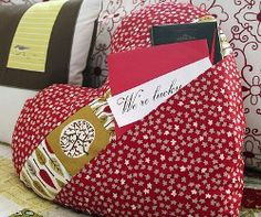 The Pocket Full of Love Pillow tutorial teaches you how to make throw pillows in the shape of a heart with pockets for holding valentines from your secret admirers!