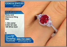 A stunning ruby set in 18k white gold with diamonds - this ring is a timeless classic