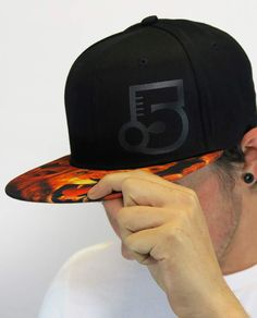 Turn heads with this snap back. An understated black Point 5cc logo keeps  all eyes 864cda172817