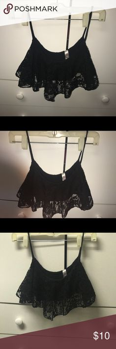 Black lace crop top/beach top Black lace crop top. Super cute with High waisted pants/shorts. Or even as beach wear. 2 Cute Tops Crop Tops