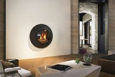 The Focus Lenfocus has a singular presence without being intrusive.  The #Focus #Lensfocus is a #wall-mounted #gas-fired #stove adds an almost space-age presence to a room. Fully enclosed with a lens-like double glazed viewing window it provides a striking focal point and a efficient source of heat.