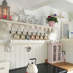 Hang mugs under cupboards/shelves over the hatch space