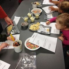 """body science: digestion station: """"stomach"""" in zip lock bags that help demonstrate digestion (child pours their choice of different foods into bag (pudding, crackers, cereal) and then squishes it). lung station: child breathes in and out of paper bag deeply, deflating and inflating """"lungs"""""""