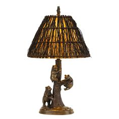 Bear cubs clamber up a tree in the decidedly charming Cal Lighting Bear Table Lamp. This rustic table lamp is capped by a rugged twig shade and topped by a bear shaped finial. It requires one incandescent bulb (not included). Light Table, Lamp Light, Rustic Table Lamps, Lamp Table, Black Forest Decor, Light Bulb Wattage, Lamp Shade Store, Resin Table, Transitional Wall Sconces