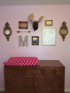 Gorgeous pink and gold finishes pulled my collage together for this girls nursery. From a cute moose head to gold mirrors, all of the pieces of the collage are Hobby Lobby, homemade, gifted or thrifted.