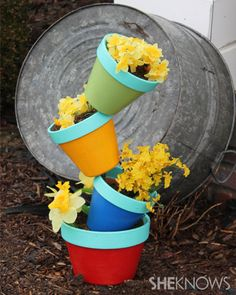 Outdoor fun: Create your own garden art! - Turn boring terracotta pots into unique and colorful garden art with just a few simple and inexpensive items. #DIY #howto #crafts #spring