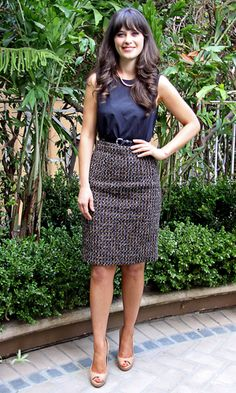A pencil skirt belted at the waist with a tucked in top flatters many figures & is perfect for the office! (Zooey Deschanel)