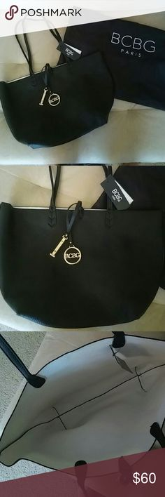 BCBG Paris Reversible Tote Black/White Brand new never used BCBG bag. Purchased on posh and just wasn't my style! Comes with dust bag! Bags Shoulder Bags