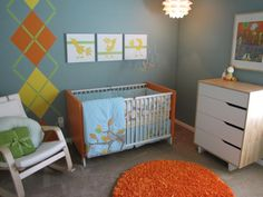 orange, aqua, yellow and gray nursery. LOVE the argyle strip on the wall! Who of my friends can paint???