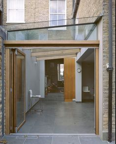 Glass lean to. Energy efficiency? Looks fab though!