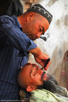 An Uyghur man is getting a shave in the old part of Kashgar, Xinjiang province in the far west of CHINA