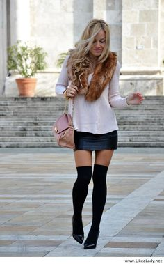 Over the knee socks, leather skirt and faux fur collar
