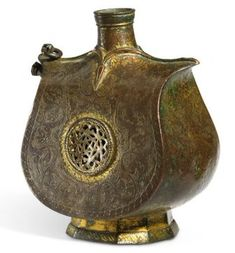 A beautiful late c.-early c. Ottoman water flask (matara in Turkish) made out of tombak, a brass alloy with high copper content. In the center, you can see a Seal of Solomon, not uncommon on Medieval Muslim drinking cups, flasks and other containers. Seal Of Solomon, King Solomon, Prophets And Kings, Symbols Of Islam, Water Flask, Days Of Creation, Solomons Seal, Arabic Design, Islamic World