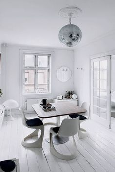 #white #diningroom / this reaffirms my need to have a disco ball in our lounge. love it!