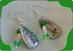 http://diginanchors.com/EarringsAlure_WideBladeGreen - Beaded earrings made with a fishing lure with a wide, beautifully painted green, pink and silver spinner blade. Blade spins on the wire to draw the eye to the wearer.To enhance the beauty of the earrings, fire-polished sparkling green beads and clear crystals are added.The handcrafted dangling earrings are 2 Inches long and 5/8 in wide. The earwires are made of surgical stainless steel and are silver plated.