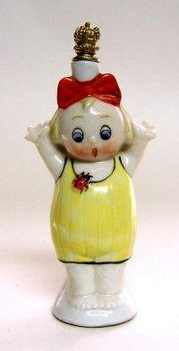 Whimsical child and ladybug figural porcelain perfume bottle.